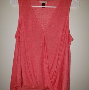 Orange wrap tank top with bottom knot.